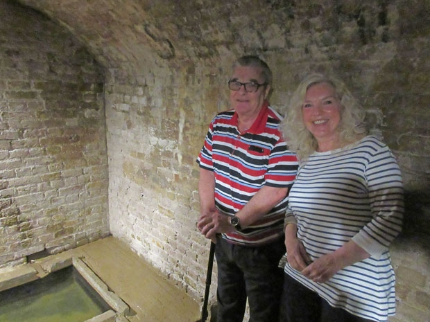 David Richards and Pat Hicks fulfilled a lifetime's ambition to descend the twelve steps to the underground tanks filled by spring water at the historic Barnet Physic Well.