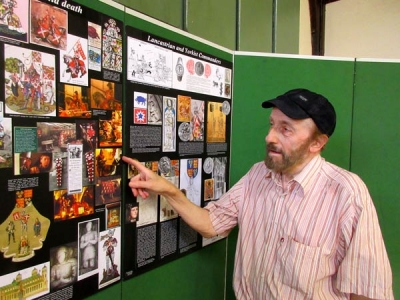Geoffrey Wheeler with some of his many drawings, photographs of reproductions of events and characters involved in the Wars of the Roses and the 1471 Battle of Barnet