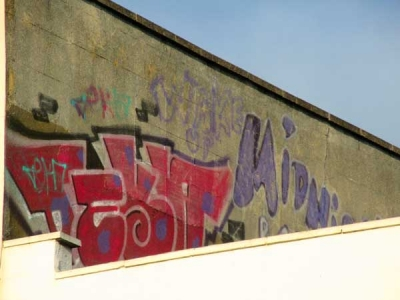 The handiwork of High Barnet's graffiti artists is visible above shops such as Specsavers and Greggs'.