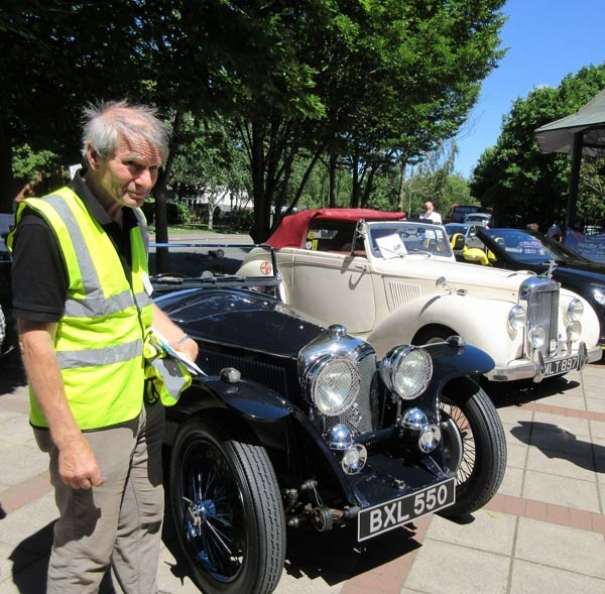 Chris Nightingale beside the 1935 blue Riley sports car that was refused access to the Spires shopping centre. Next to them is a 1951 Grey Lady Alvis