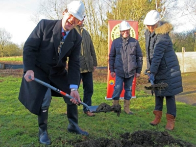 The Mayor of Barnet, Councillor Hugh Rayner, helps with the spadework