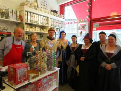 Hopscotch sweetshop, in High Street – which is selling a specially-prepared blend of Battle of Barnet tea –  had a visit from members of the Medieval Siege Society. From left to right, Michael and Alice Kentish, Chris Farncomme (King Edward IV), Liz Bowman, Jenny Mix, Linda Godden, Peter Grande and Tracey Jackson.