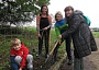 Preparing a flower bed was the challenge for the Slane family. From left to right, Ollie Slane (7), Sarah Alun-Jones, Grow's outdoor learning manager, Isla Slane (11) a pupil at Totteridge Academy, and Mrs Anne Slane.