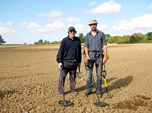 The hunt is on: Sam Wilson (right) project supervisor for the Battle of Barnet archaeological investigation with metal detecting volunteer, Eric Weinrabe at work in fields off Kitts End Lane last autumn