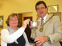 Councillor Hugh Rayner, Mayor of Barnet, presenting Annette Chmiel with the Centenary Cup