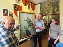 Medieval military artist Graham Turner with his painting Challenge in the Mist. From left to right, Mike Noronha, curator, Barnet Museum; Graham Turner; and Fiona Jones who is leading the museum's bid for financial support from the Heritage Lottery Fund.