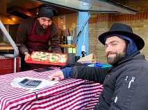 Master pizzaiolo Giovanni Marino and Noah Hirsch in their Citroen van at the rear of the Spires