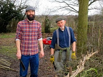 David (left) and John Sawkins working on the double-brush Hertfordshire hedge