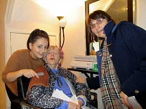 Greta Nellie Druce, 102 in November, getting ready for a sing song with her hair stylist Pammie Sardillo (left) and her daughter Diane Druce at JJ's hairdressing salon in Alston Road, Barnet.