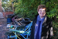 Lesley Graham with rubbish removed from neglected woodland