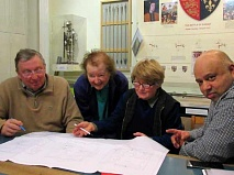 Trustees from left to right: Dennis Bird, Carla Herrman, archivist Dr Gillian Gear, co-curator, Mike Noronha