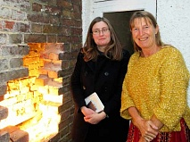 Removing bricks in a cottage wall exposed the hidden wallpaper.  Emma Hardy (left) with Penny Mayes.